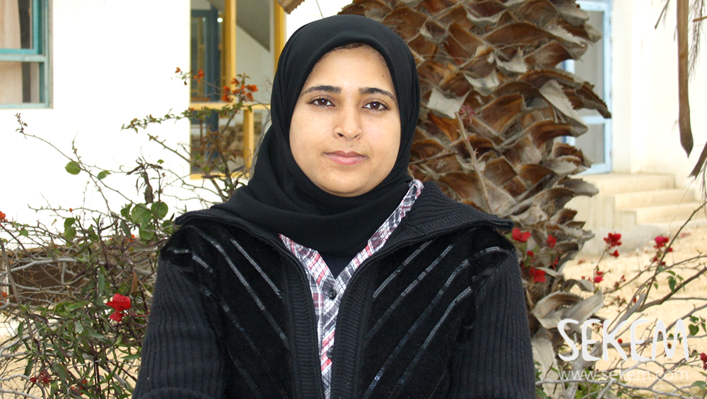 Noura Nasser takes care of children with handicaps in SEKEMs School dedicated to them.