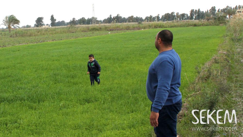 Ibrahim Al-Naggar with his son on his farm.