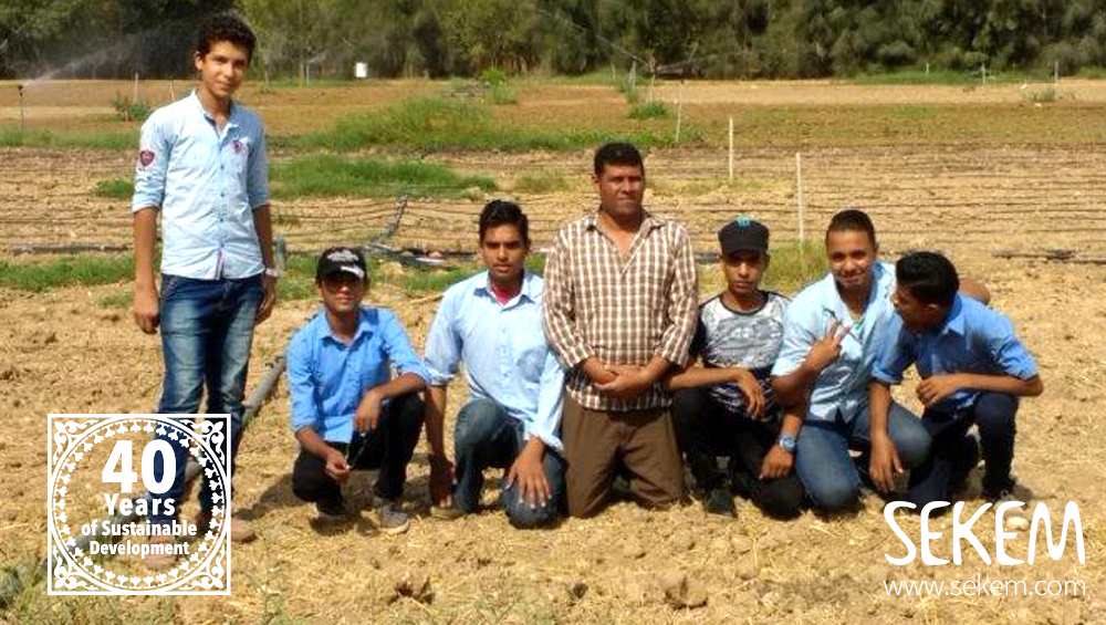 Some of the new generation of Biodynamic farmers with their teacher on a SEKEM field.